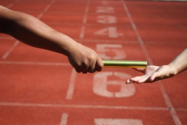 Relay race baton exchange