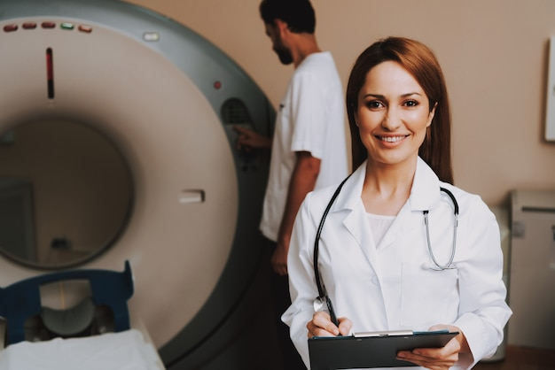 Reliable female doctor near mri scanner machine.