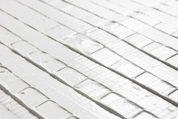 구호 흰색 패턴 석고 질감 표면 근접 촬영 치장 용 벽토 장식 크리 에이 티브 디자인 수리 개념