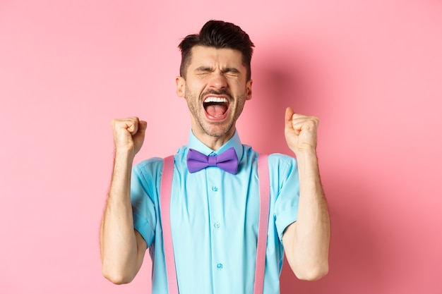 Relieved man shouting from happiness and joy