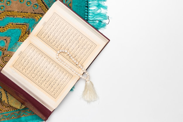 Religious mat with holy book and bracelet