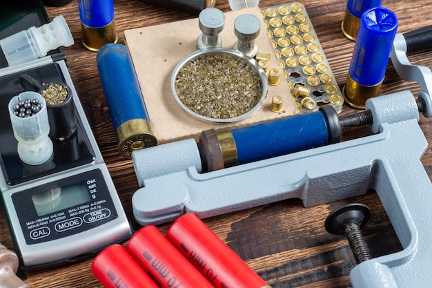 Reloading process shotgun shells with special reload equipment.