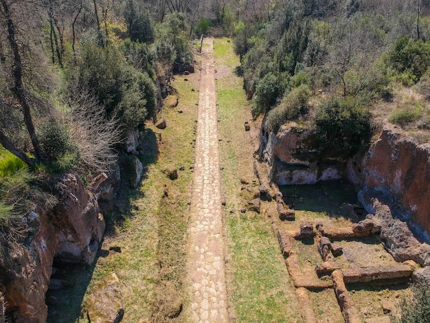 Remains of etruscan tombs on the sides of road amerina. aerial view