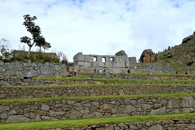 The remains of temple of the three window in machu picchu inca citadel, cusco region, peru