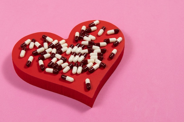 Remedy for the treatment of high blood pressure, heart-shaped wood with remedies on top