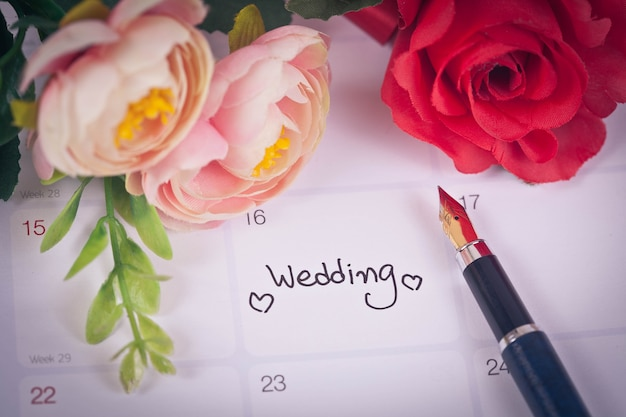 Reminder wedding day in calendar planning and fountain pen with color tone.