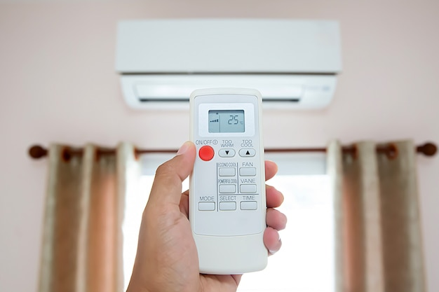 Remote control air condition set on 25 degree temperature
