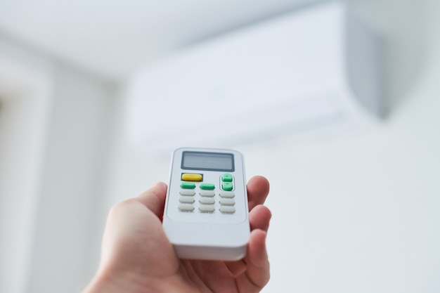 Remote control for air conditioner in hand