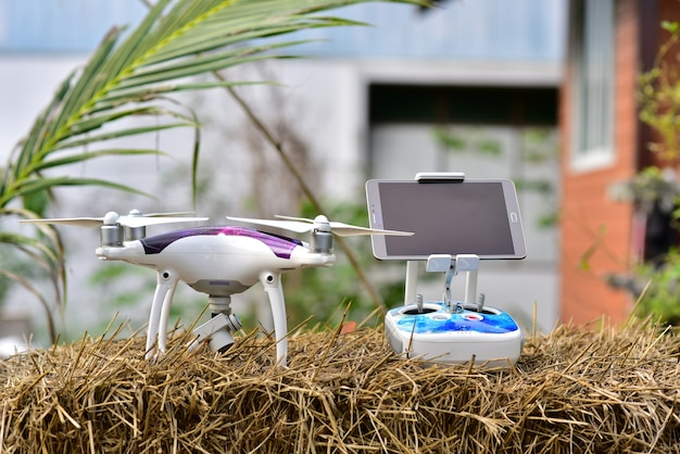 Remote control and drone on straw rice