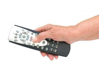 Remote control in hand isolated , entertainment