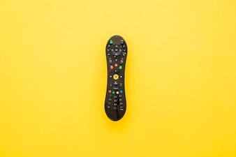 Remote control on yellow background