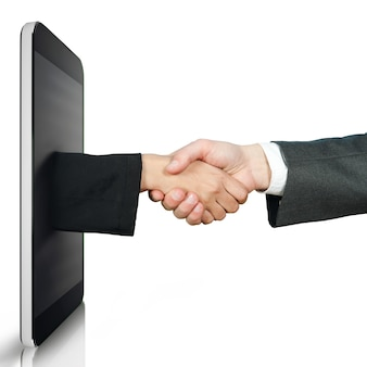 Remote handshake with a hand coming out of the tablet