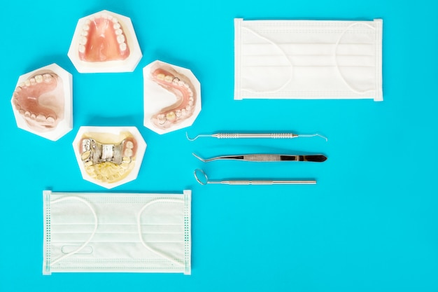 Removable partial denture (rpd.) on blue background, flat lay, top view.