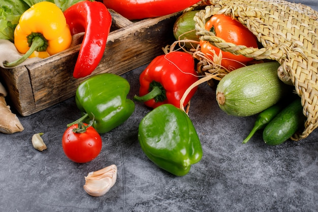 Removing mixed vegetables out of a rustic basket.