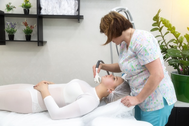 Removing wrinkles on the face and neck with massage.