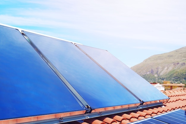 Renewable energy system with solar panel for electricity and hot water