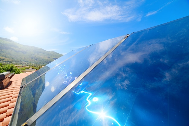 Renewable energy system with solar panel for hot water