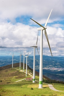 Renewable energy. wind turbines, eolic park in scenic landscape of basque country, spain.