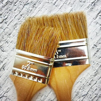 Renovation brush on wooden white cracked texture