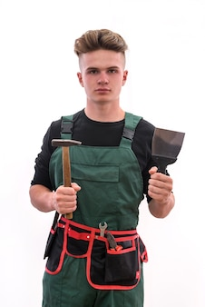 Renovation concept. young man with tools isolated on white wall