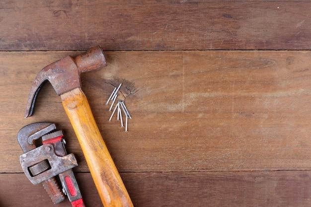 Renovation tool on wood background