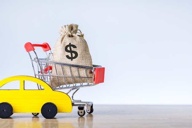 Rent or buy car concept. auto insurance. model car with money bag.
