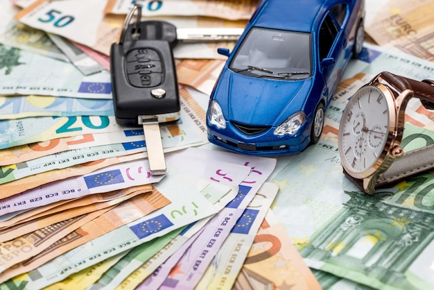 Rent car conception, car with keys and watch on money