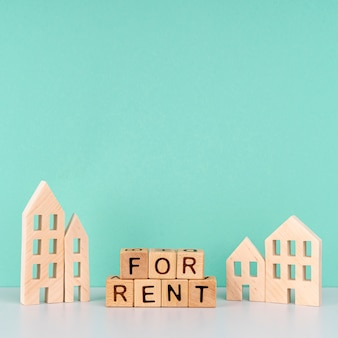 For rent lettering on blue background