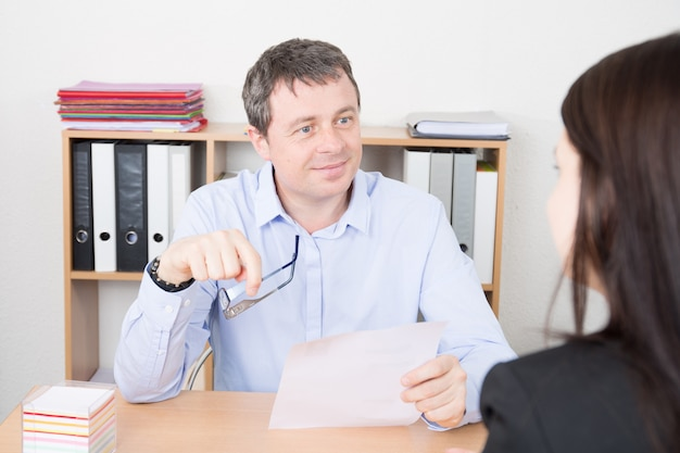 Rep business man interviewing female job applicant in office