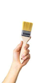Repair brush in the hands of a male isolate. selective focus.
