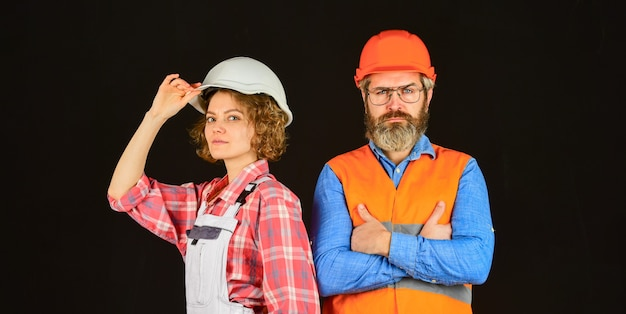 Repair and building. real estate deal. couple of architect wear hardhat. new house construction concept. portrait of family wearing hardhat. construction worker in protective helmet.