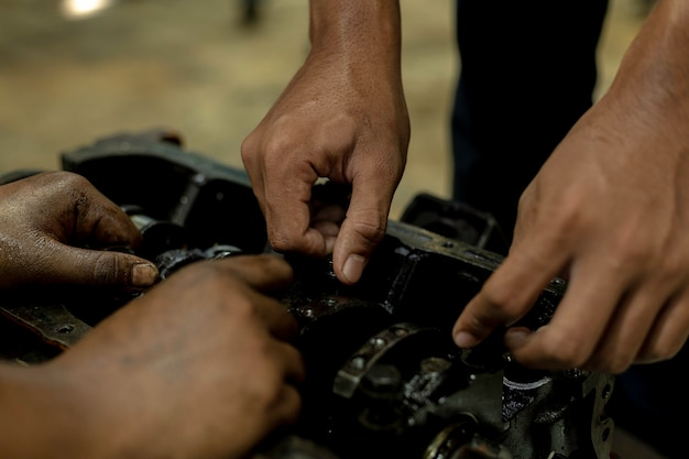 Repair a car use a wrench and a screwdriver to work.safe and confident in driving. regular inspection of used cars.