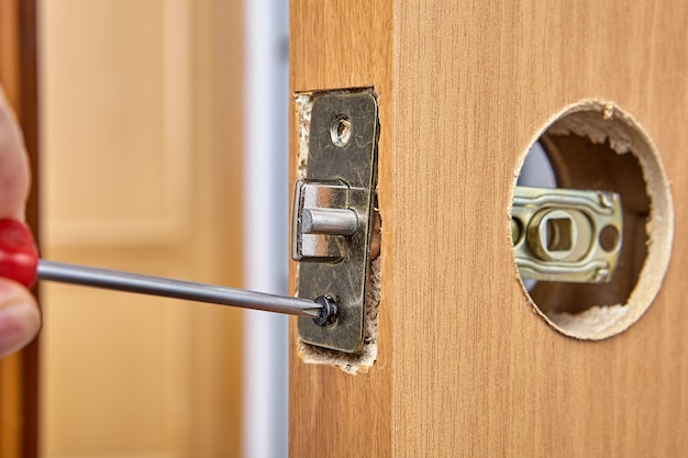 Repair door lock in room yourself, replacement latch with plate assembly.
