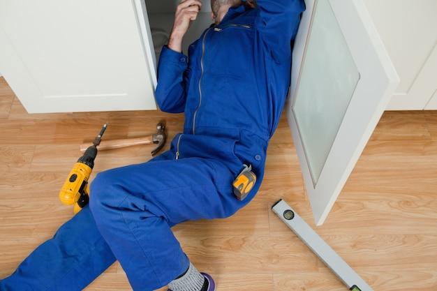 Repair man fixing something