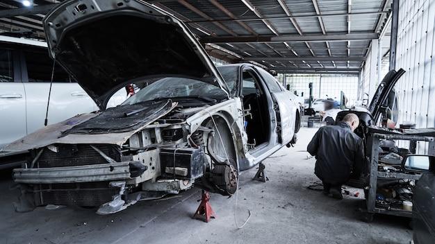 Repair of an old broken car at auto service