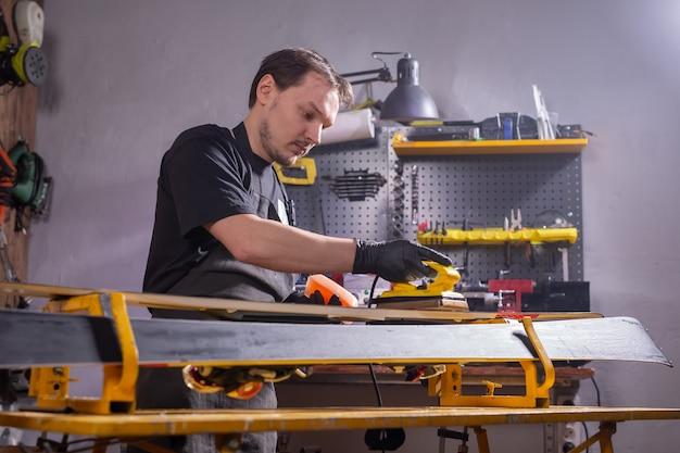 Repair and people concept - ski repairing in the service