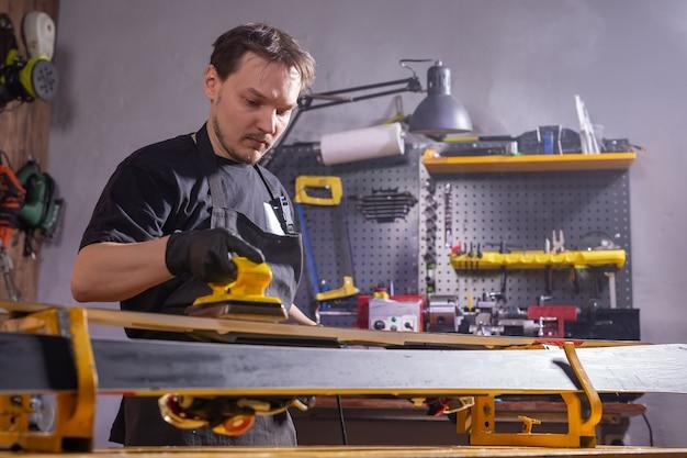 Repair and people concept - ski repairing in the service.