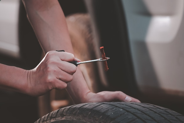 Repair tires recap patch a tyre ,flat tire the tire is leaking from the nail can a tire be repaired by self,patch on a punctured tire .