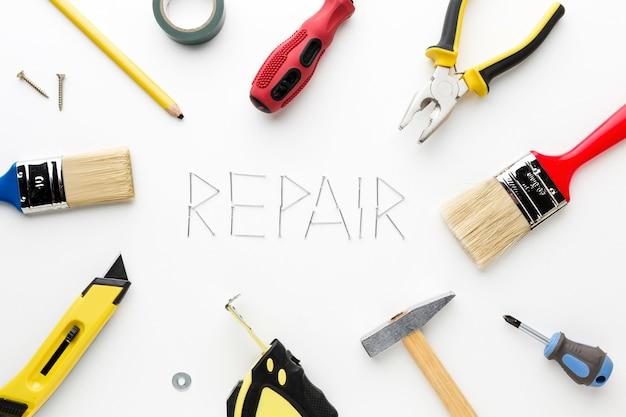 Repair word written with nails and repair utensils