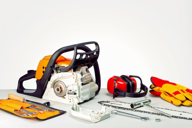 Repairing a chainsaw in workbench. place for text. concept repair gasoline powered tools.