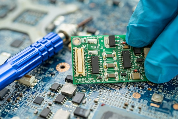 Repairing inside of hard disk by soldering iron integrated circuit