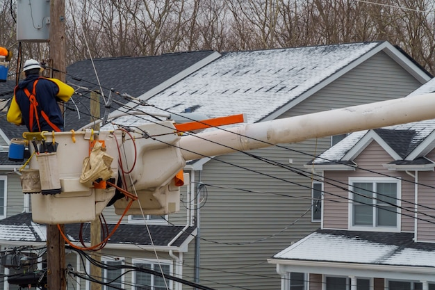 Repairing power lines after on them in snow storm