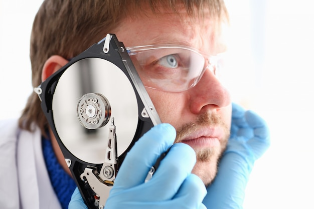 Repairman attached the hard drive of the