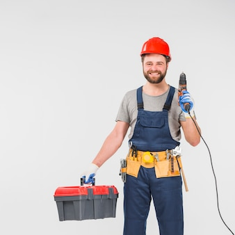 Repairman with tool box holding drill