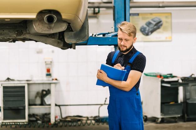 Repairmen inspectingvehicle