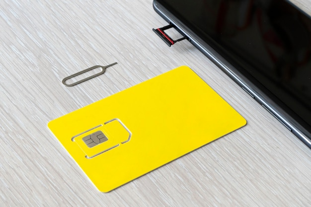 Replacement of nano sim card chip in modern smartphone, close-up view. copyspace, empty space for design and lettering