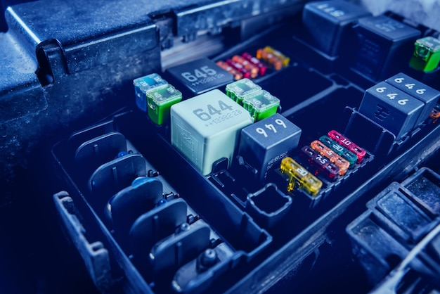 Replacing fuses in the fuse box of the car.