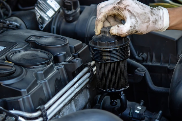 Replacing the oil filter on the car.
