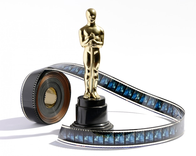 Replica oscar statue with a roll of movie film