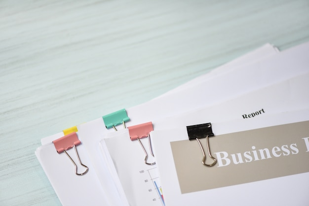 Report paper document present financial with paper clip and business report